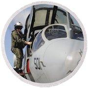 An Airman Makes A Final Look Over An Round Beach Towel