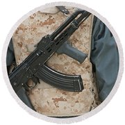 An Ak-47 Rests On The Sling Of An Round Beach Towel