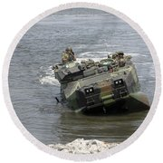 An Amphibious Assault Vehicle Climbs Round Beach Towel