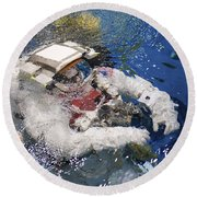 An Astronaut Is Submerged In The Water Round Beach Towel by Stocktrek Images