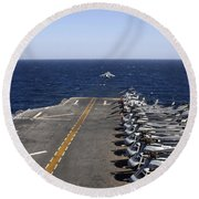 An Av-8b Takes Off From The Flight Deck Round Beach Towel
