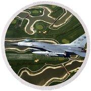 An F-16 Fighting Falcon Flies Near Base Round Beach Towel