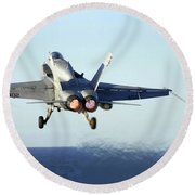 An Fa-18c Hornet Launches Round Beach Towel by Stocktrek Images