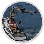An Hh-60g Pave Hawk Performs A Hoist Round Beach Towel