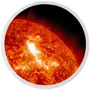 An M8.7 Class Flare Erupts On The Suns Round Beach Towel