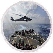 An Mh-60r Sea Hawk Transfers Supplies Round Beach Towel