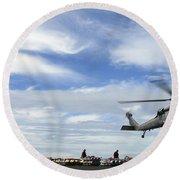 An Mh-60s Sea Hawk Lifts A Pallet Round Beach Towel