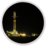 An Oil Rig At Night Round Beach Towel