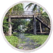 An Old Stone Bridge Over A Canal In Alleppey Round Beach Towel