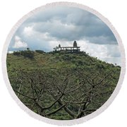 An Old Temple Building On Top Of A Hill With A Lot Of Clouds In The Sky Round Beach Towel