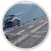 An Sh-60 Sea Hawk Helicopter Lands Round Beach Towel
