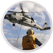 An Sh-60b Sea Hawk Helicopter Releases Round Beach Towel