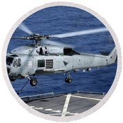 An Sh-60b Seahawk Helicopter Performs Round Beach Towel