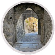 At The End Of The Passageway Round Beach Towel