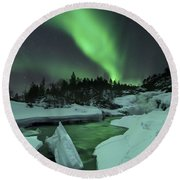 Aurora Borealis Over A Frozen Tennevik Round Beach Towel