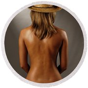 Bare Back Of A Suntanned Woman In A Straw Hat Round Beach Towel