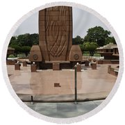 Base Of The Jallianwala Bagh Memorial In Amritsar Round Beach Towel
