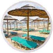 Beach Umbrellas On Sandy Seashore Round Beach Towel by Elena Elisseeva