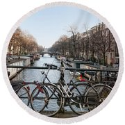 Bikes On The Canal In Amsterdam Round Beach Towel