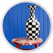 Blach And White Vase On Stool Against Blue Wall Round Beach Towel