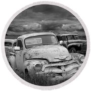 Black And White Photograph Of A Junk Yard With Vintage Auto Bodies Round Beach Towel