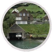 Boat House On A Mountain Slope On The Shore Of Lake Lucerne In Switzerland Round Beach Towel