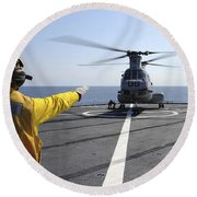 Boatswain's Mate Directs A Ch-46 Sea Round Beach Towel