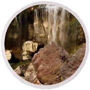 Boulders Under The Falls Round Beach Towel