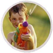 Boy Spraying Water Gun Round Beach Towel