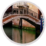 Bridge And Striped Poles Over A Canal In Venice Round Beach Towel