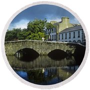 Bridge Over A River In Front Of Round Beach Towel
