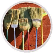 Brooms Leaning Against Wall Round Beach Towel