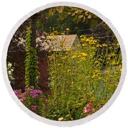 By The Light Of The Garden Round Beach Towel