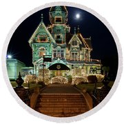 Carson Mansion At Christmas With Moon Round Beach Towel