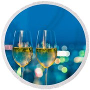 Champagne Glasses In Front Of A Window Round Beach Towel