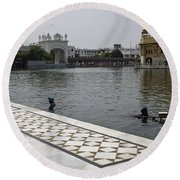 Clearing The Sarovar Inside The Golden Temple Resorvoir Round Beach Towel