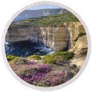 Cliffs Along Ocean With Wildflowers Round Beach Towel