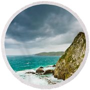 Cliffs Under Thunder Clouds And Turquoise Ocean Round Beach Towel