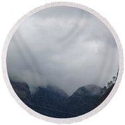Clouds Covering The Tops Of Various Mountain Peaks Round Beach Towel
