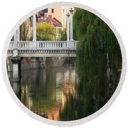 Cobblers Bridge And Morning Reflections In Ljubljana Round Beach Towel by Greg Matchick