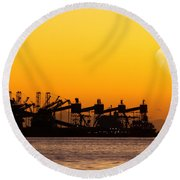 Cranes At Sunset Round Beach Towel by Carlos Caetano