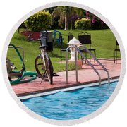 Cycle Near A Swimming Pool And Greenery Round Beach Towel