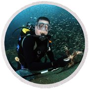 Diver Collects Invasive Lionfish Round Beach Towel