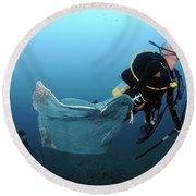 Diver Removes Invasive Indo-pacific Round Beach Towel