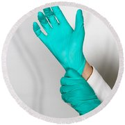 Doctor Putting On Gloves Round Beach Towel