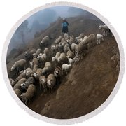 farmers bring their sheep to graze. Republic of Bolivia. Round Beach Towel