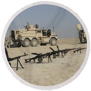 Firearms Sit Ready On A Firing Range Round Beach Towel