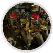 Firemen Combat A Simulated Fire Aboard Round Beach Towel