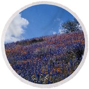 Flowers On A Hill Round Beach Towel