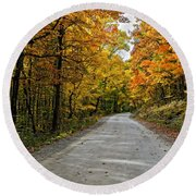 Follow The Yellow Leafed Road Round Beach Towel